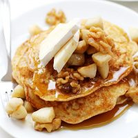 apple brie pancakes on plate with syrup