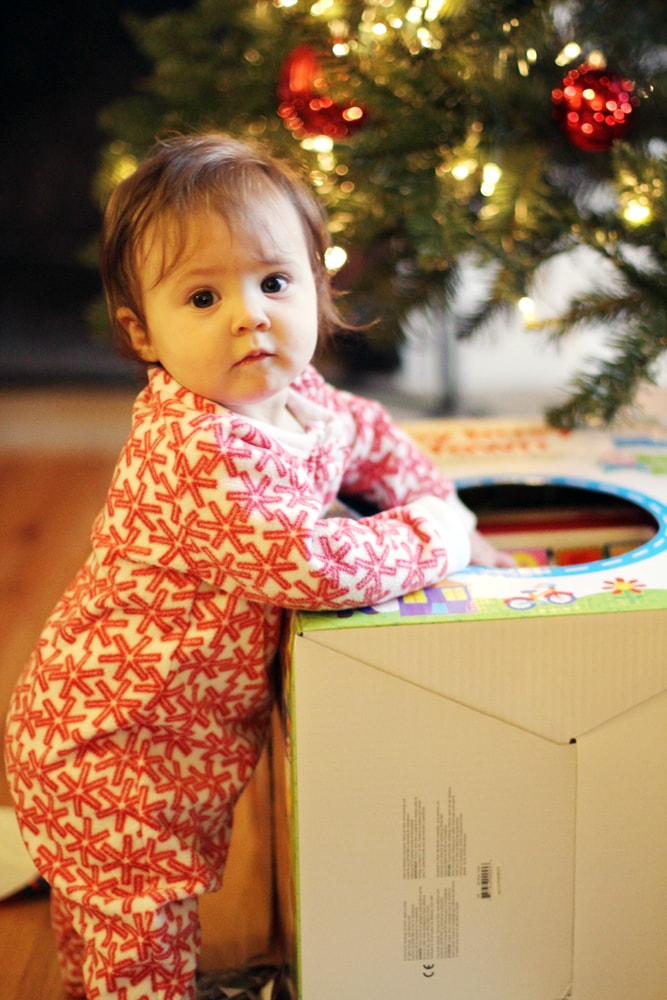 baby opening a present