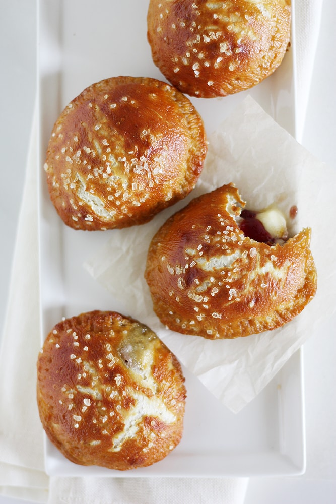 brie and jam pretzel hand pies on serving plate