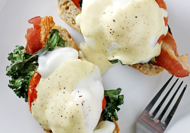 bacon, kale and tomato eggs benedict