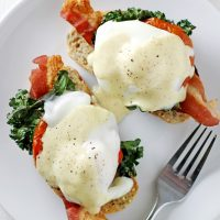 bacon kale eggs benedict on a plate