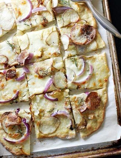 einkorn pizza crust on baking sheet