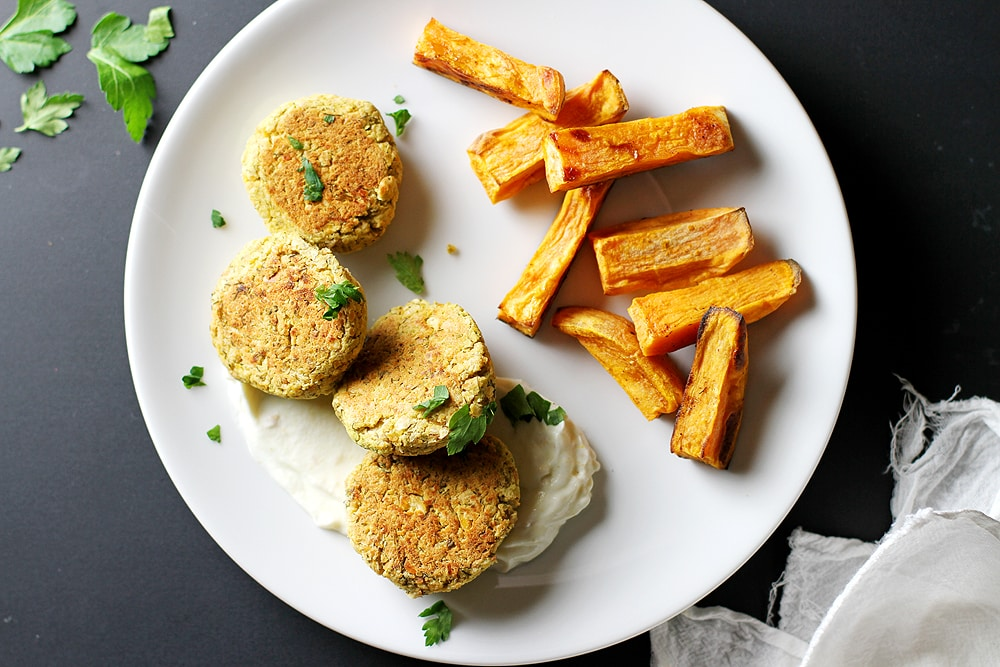 baked chickpea patties and sweet potato fries on a plate