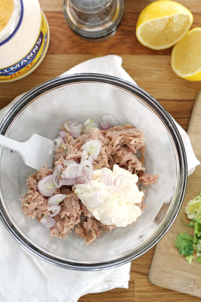 mixing tuna salad in bowl