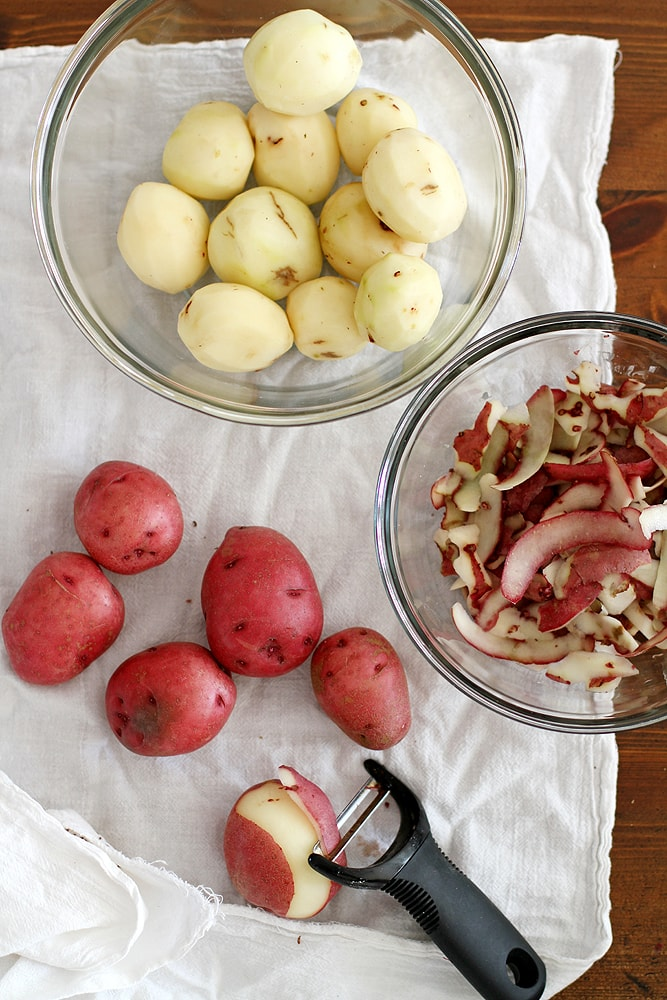 peeling potatoes on table