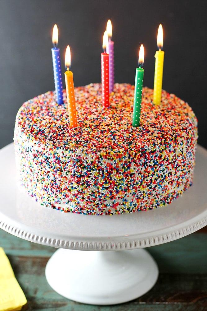 vanilla bean birthday cake on cake stand