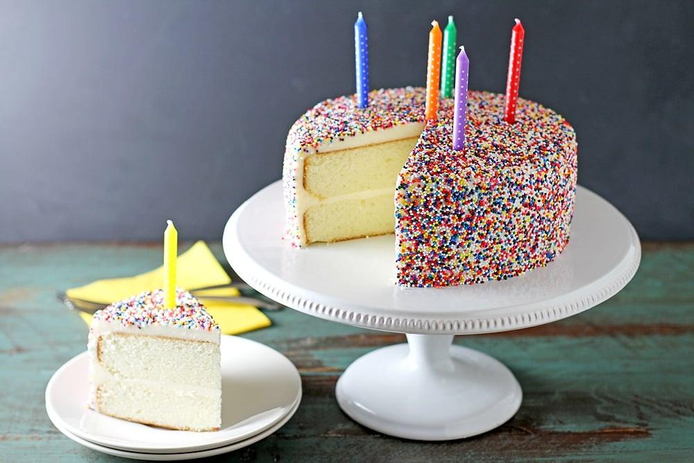 vanilla bean birthday cake with slice on plate
