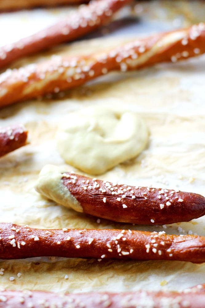close up of homemade hard pretzel rods with mustard dip