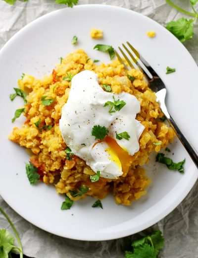 spiced lentils with poached egg on plate