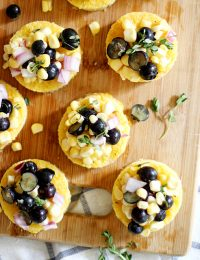 cheesy polenta bites with blueberry corn relish