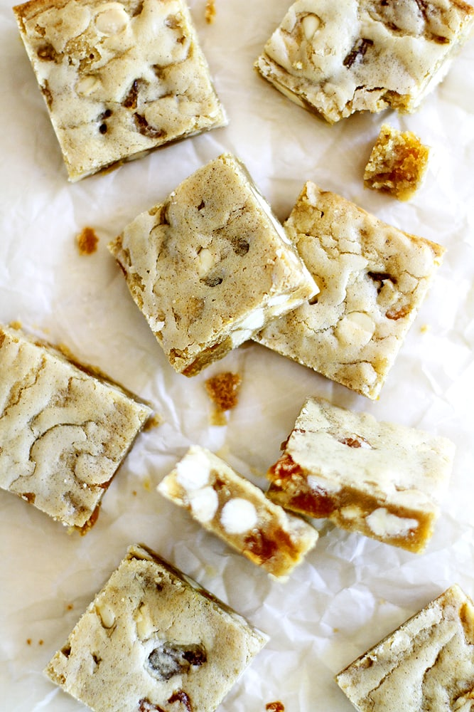 slices of apricot white chocolate blondies on parchment paper