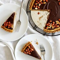 chocolate peanut butter pretzel tart on plates