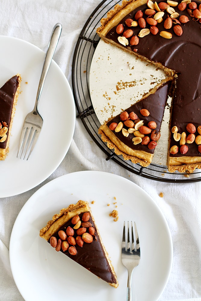 slices of chocolate peanut butter pretzel tart on plates