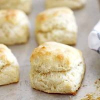flaky fluffy southern buttermilk biscuits on baking sheet
