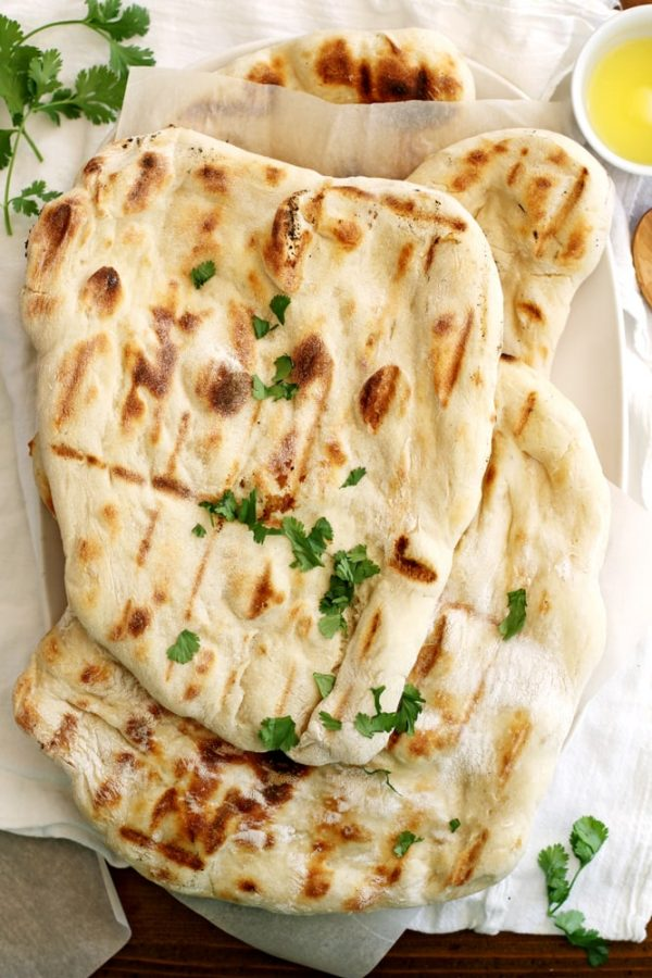 no knead grilled naan on parchment paper