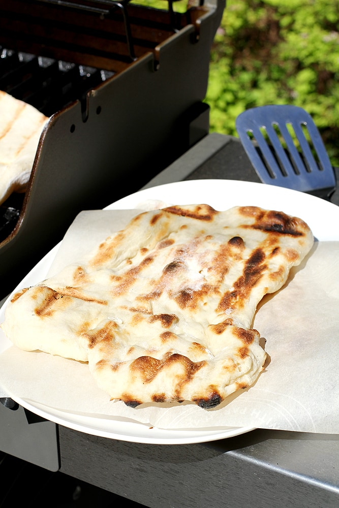 no knead grilled naan next to grill