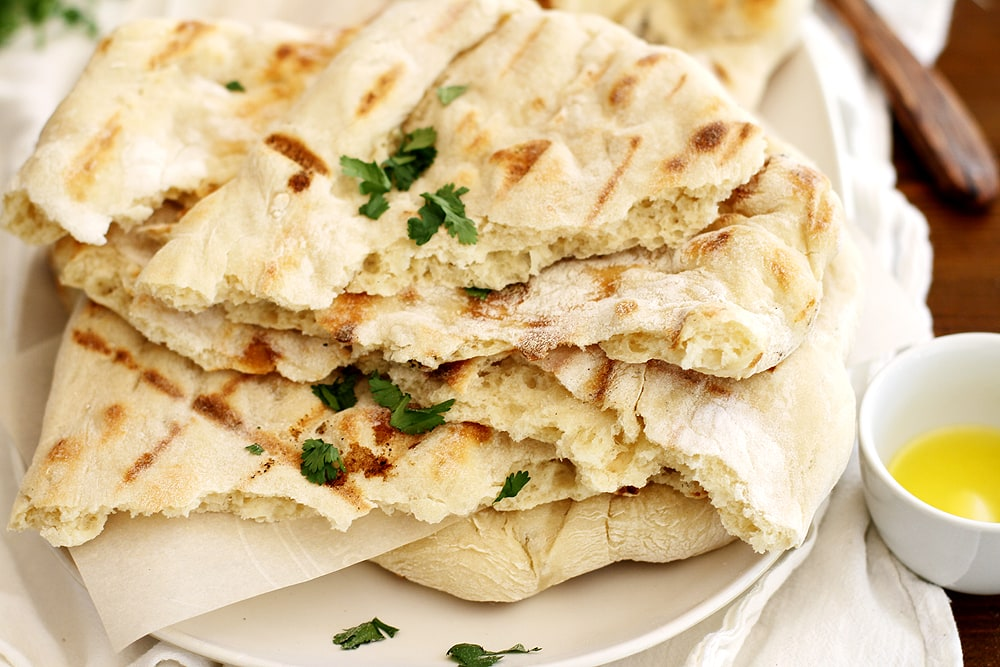 no knead grilled naan on plate