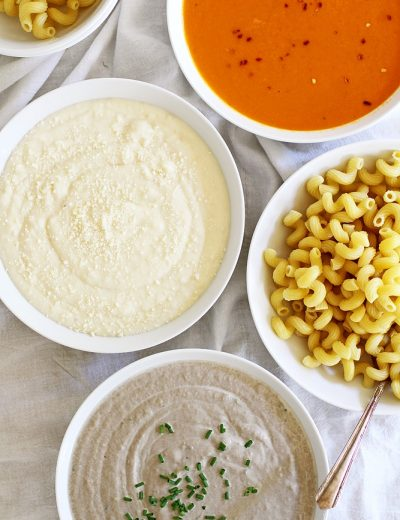 pasta sauces in bowls with pasta in a bowl