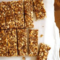 apple peanut butter granola bars on a cutting board