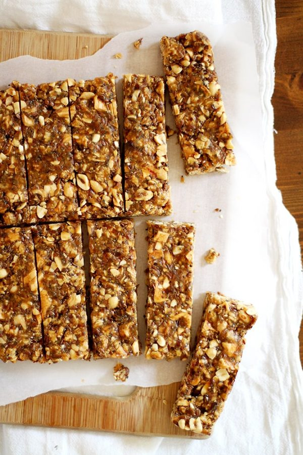 apple peanut butter granola bars on a cutting board