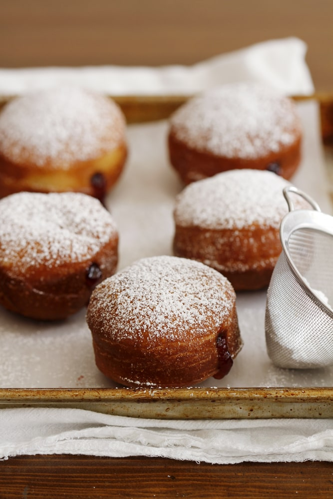 brioche doughnuts on baking sheet