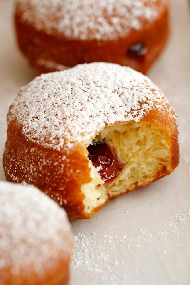blackberry jam filling inside brioche doughnut