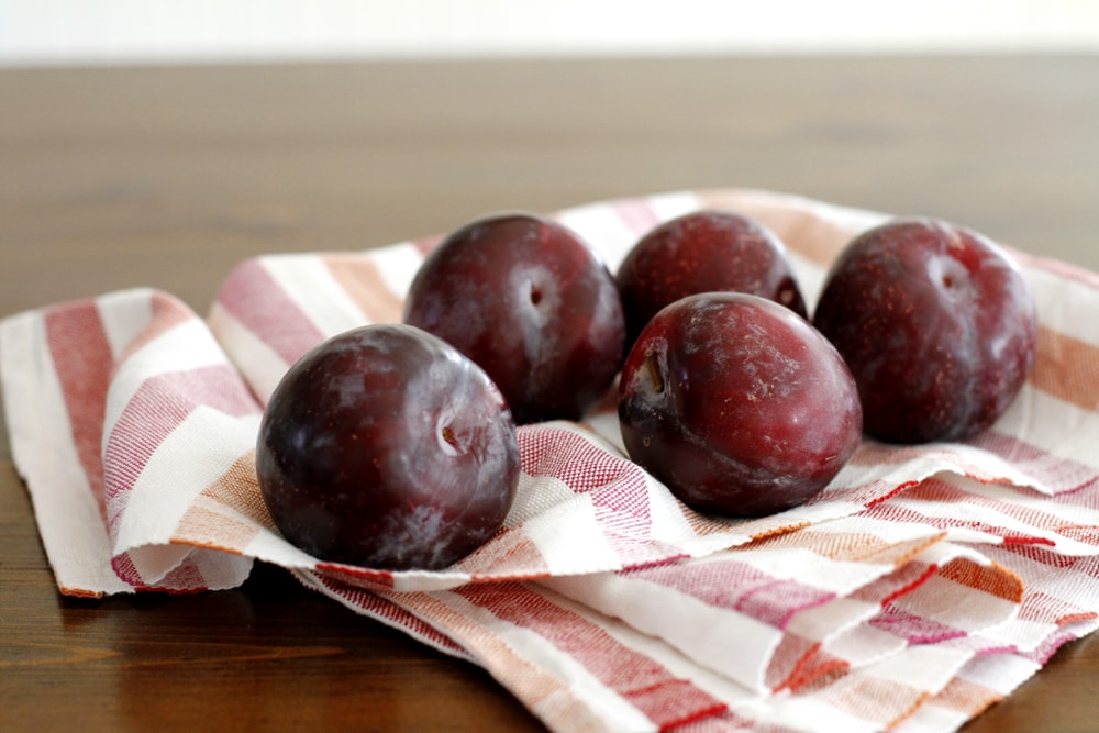 plums on a table