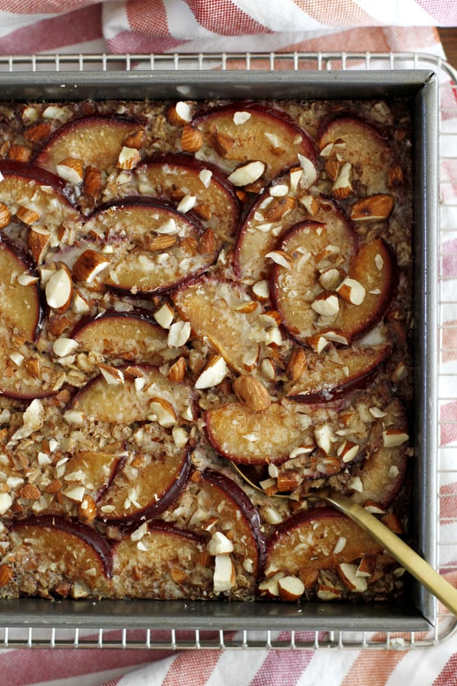 cinnamon plum baked oatmeal in pan on cooling rack