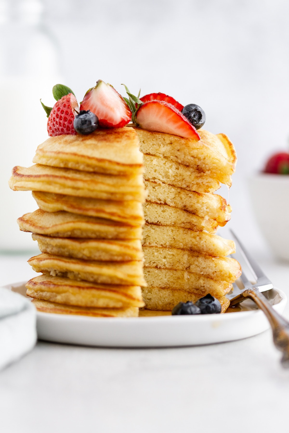 a cross section of a stack of coconut flour pancakes on a plate