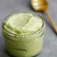 creamy avocado cilantro sauce in glass jar