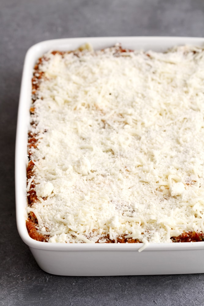 lighter lasagna bolognese in baking dish ready for oven