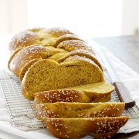 pumpkin challah sliced in cooling rack