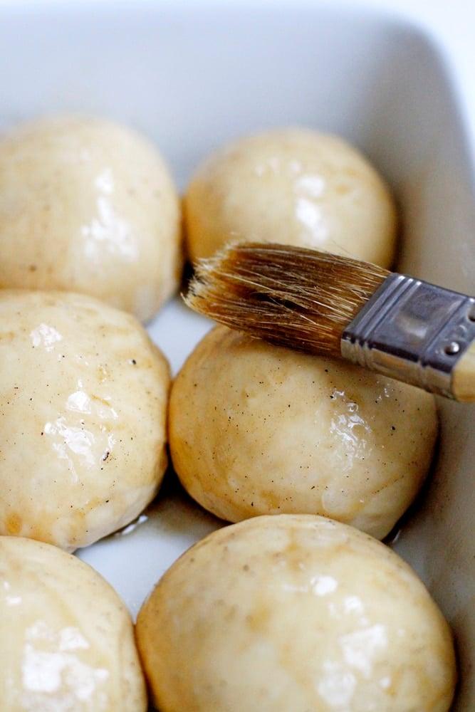 egg washing the sweet potato buttermilk rolls