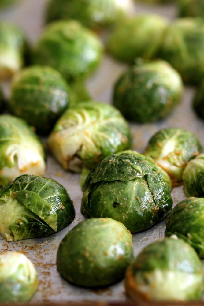 dijon roasted brussels sprouts on a baking sheet