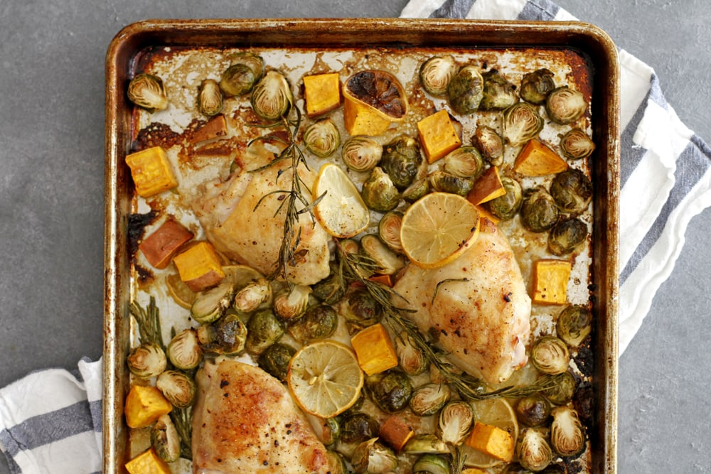 lemon rosemary chicken thighs on baking sheet