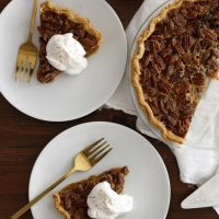 slices of pecan pumpkin pie on plates