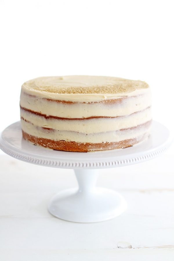 salted caramel layer cake on cake stand