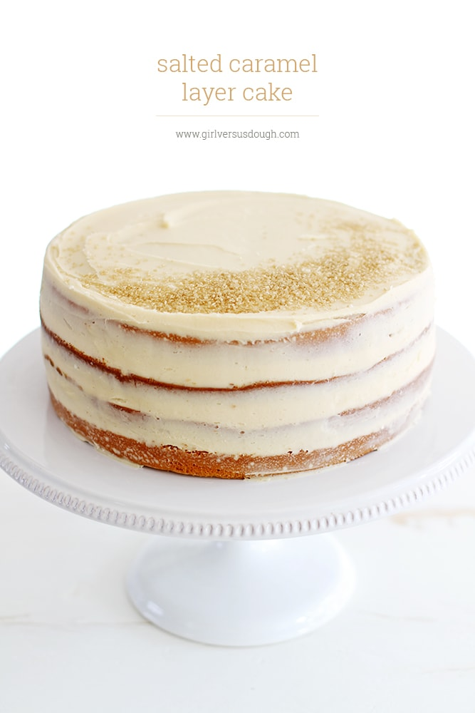naked salted caramel layer cake on cake stand