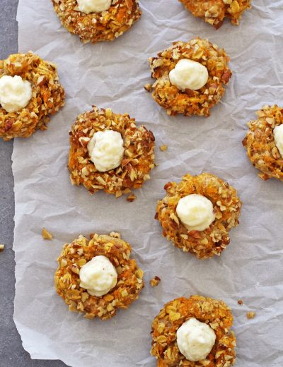 carrot cake thumbprint cookies on parchment paper