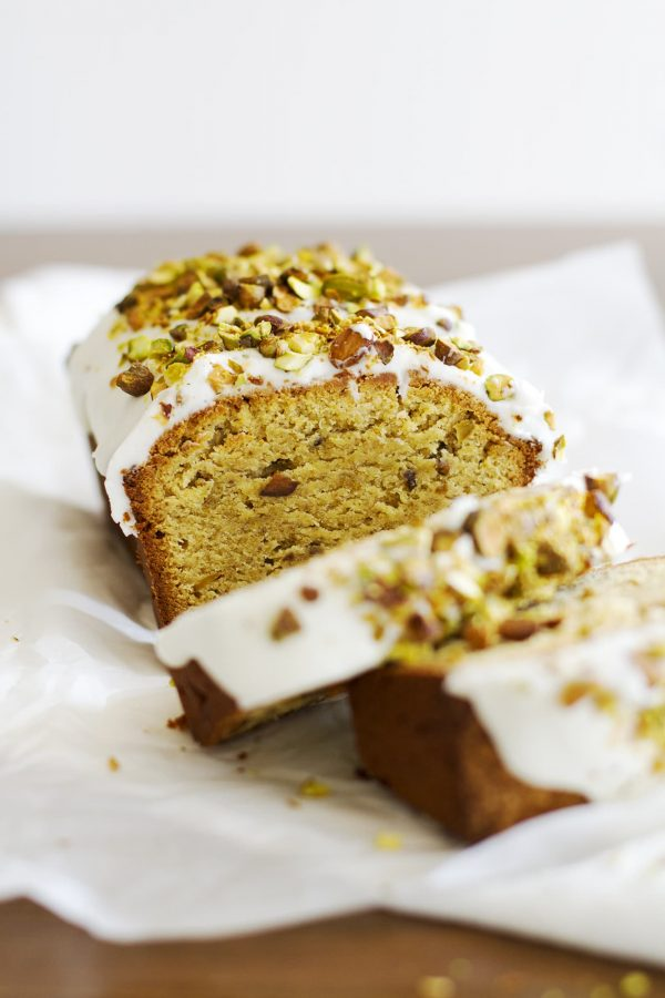 gluten free pistachio pound cake sliced on parchment paper
