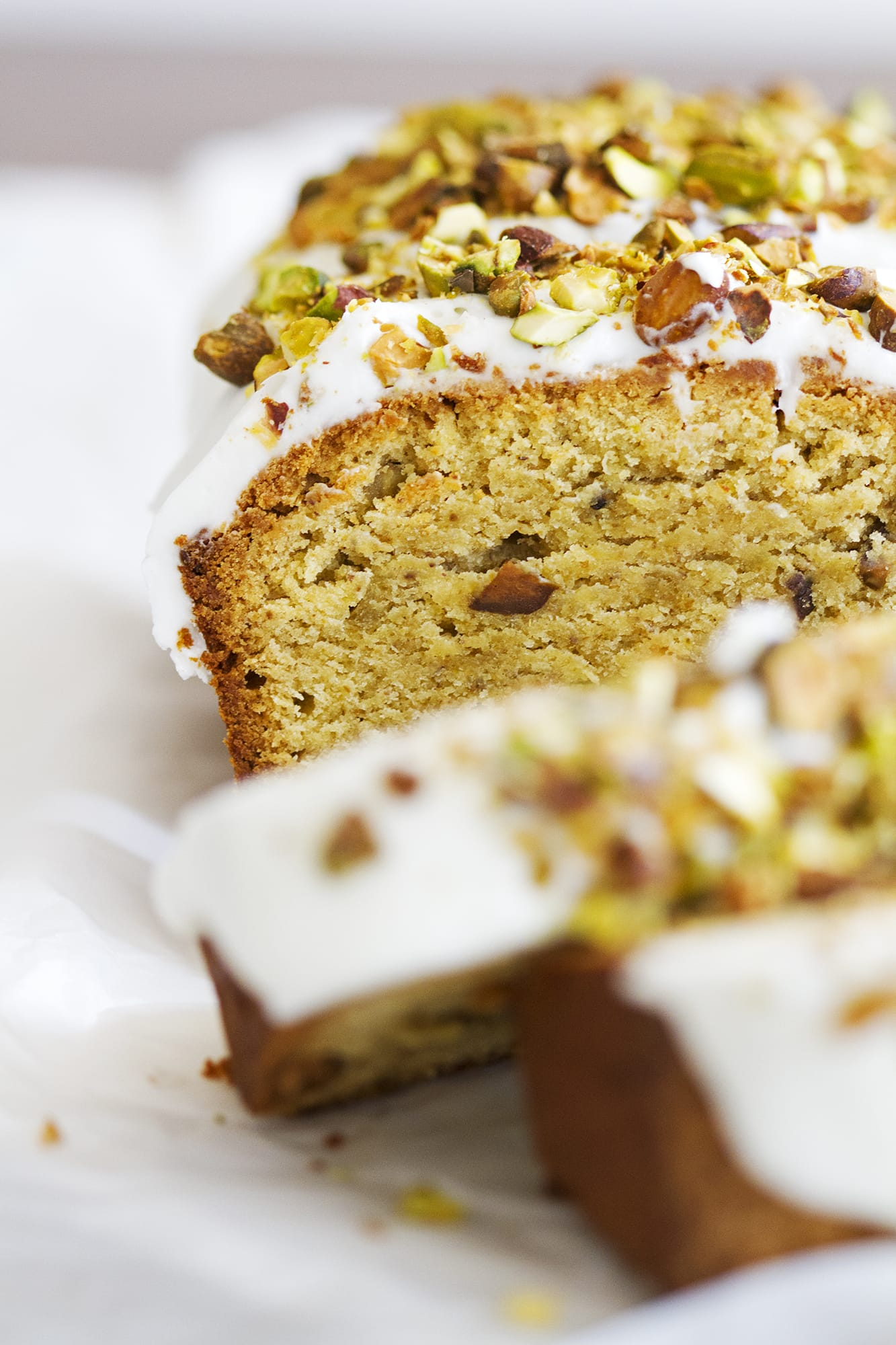 close up of slices of gluten free pistachio pound cake