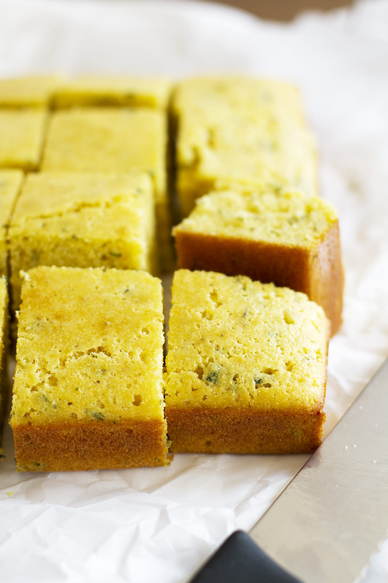 close up of sliced herb cornbread