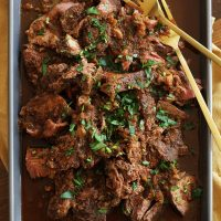 mocha rubbed slow cooker shredded beef on baking dish