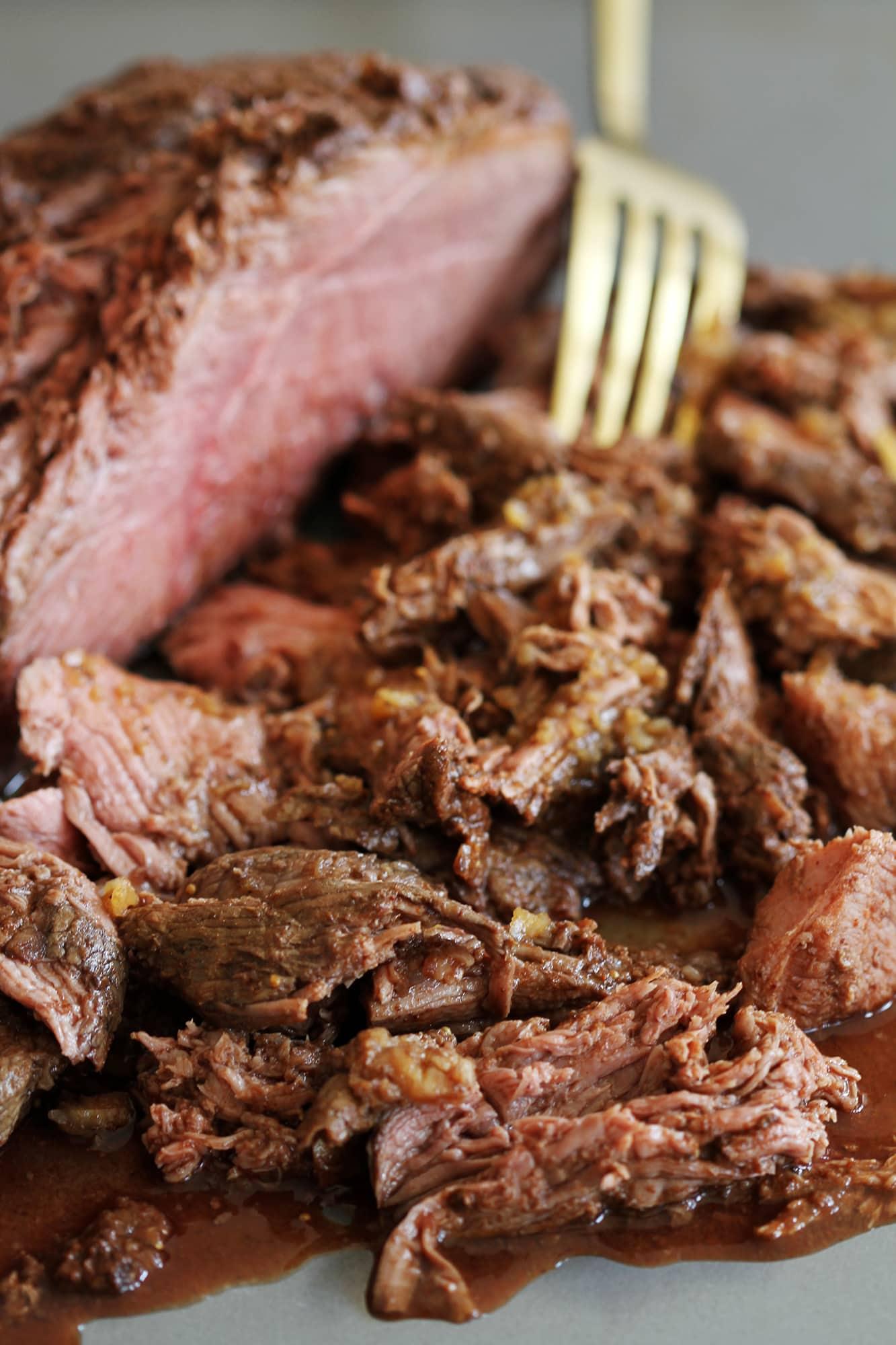 fork in mocha rubbed slow cooker shredded beef