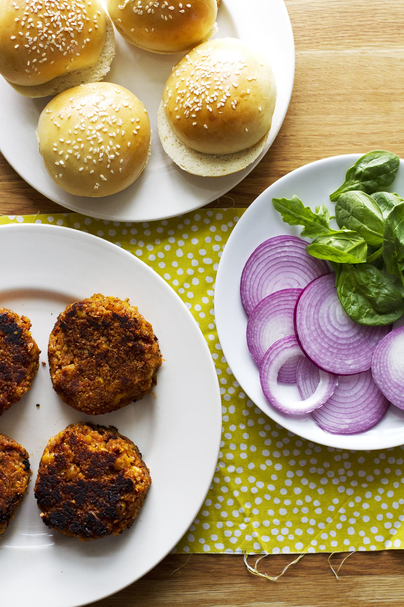 bbq veggie burgers with buns on plates