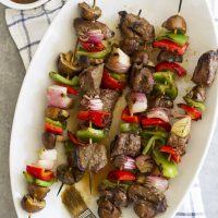 grilled steak mushroom kabobs on platter