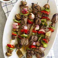 grilled steak mushroom kabobs on platter