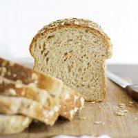 multigrain sandwich bread on cutting board