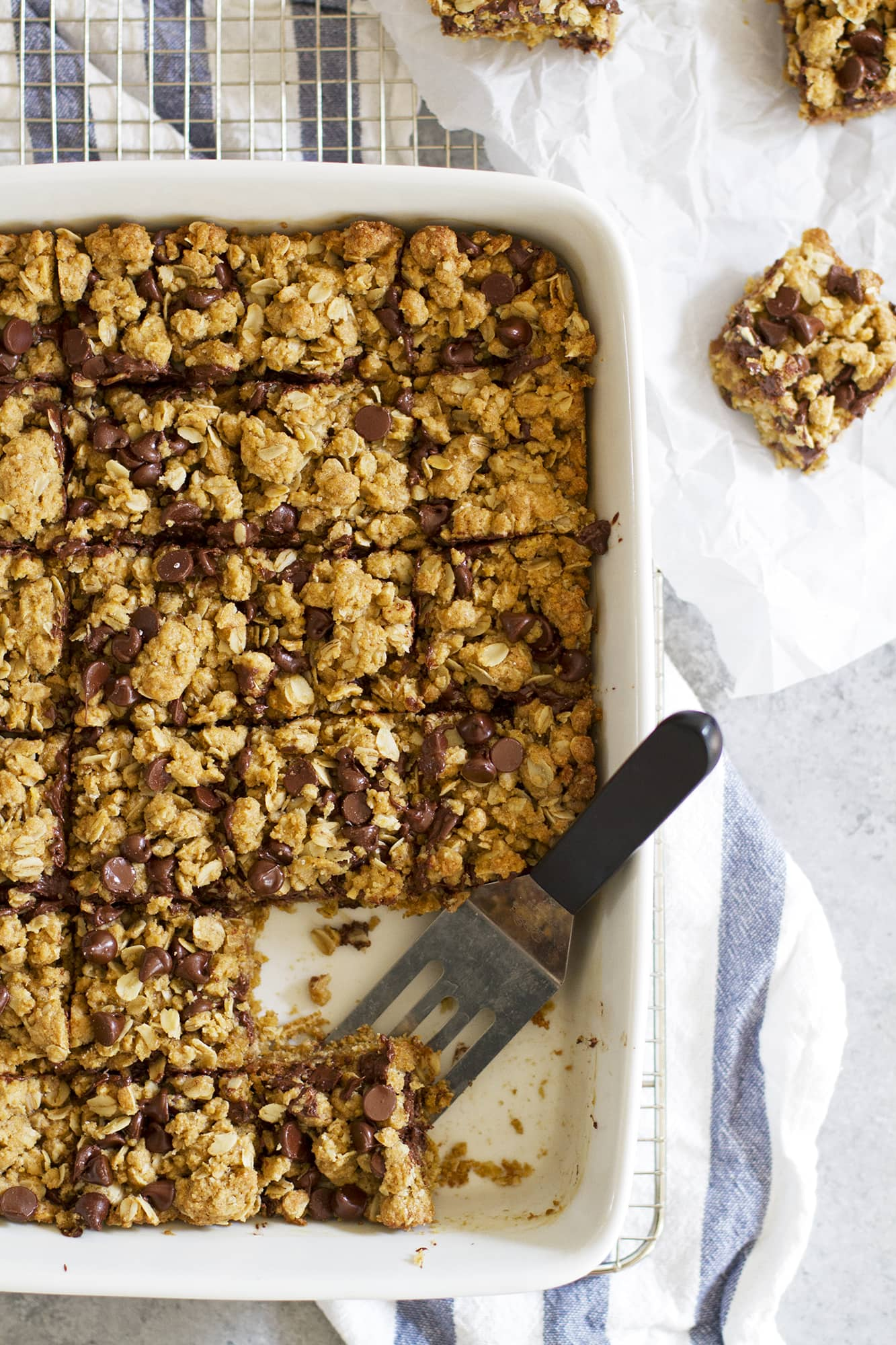 whole wheat oatmeal chocolate chip cookie bar in baking dish