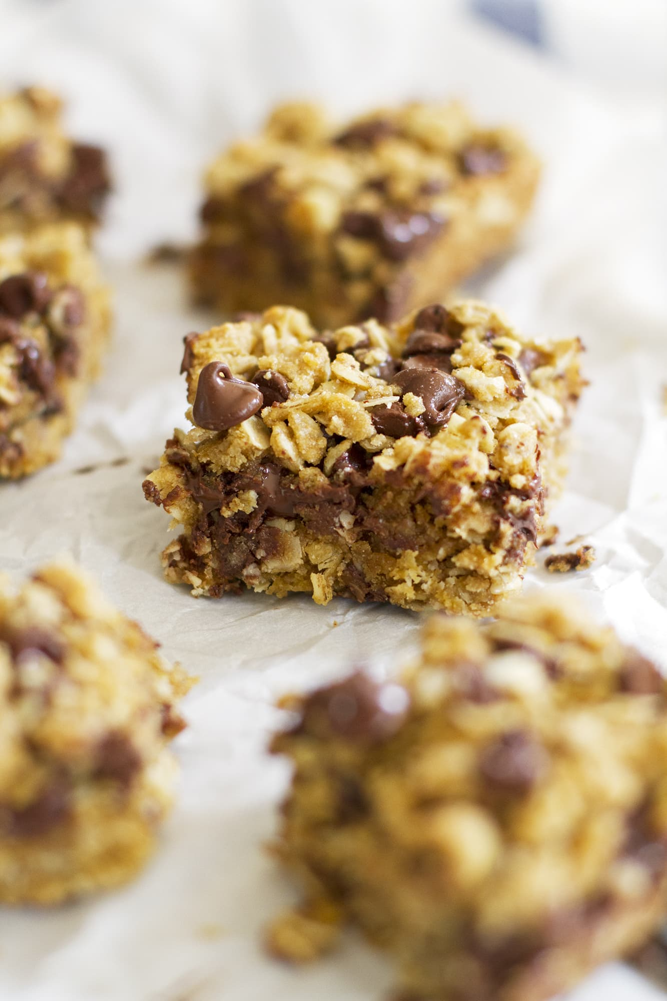 whole wheat oatmeal chocolate chip cookie bar on parchment